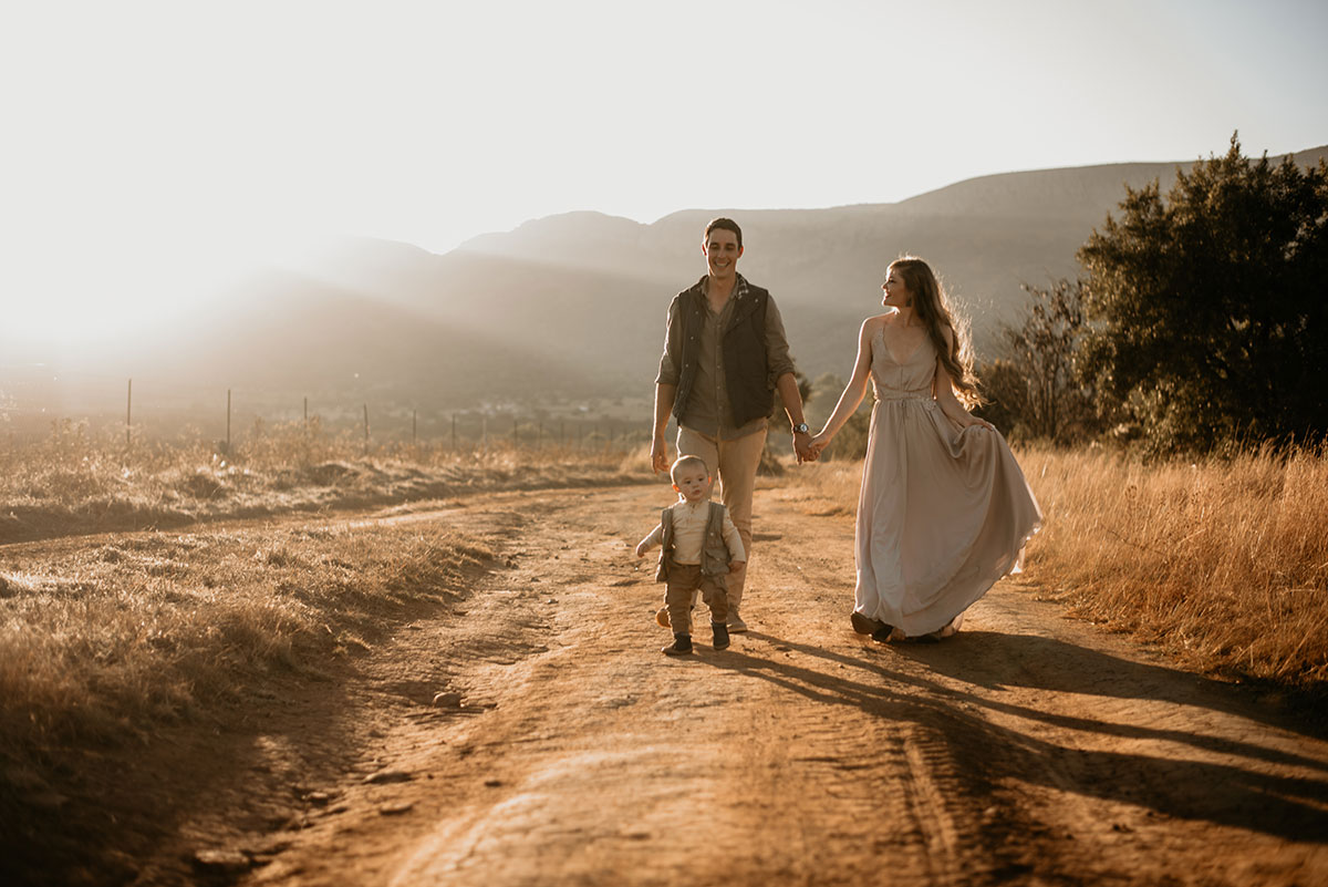 Family walking down a dirt road
