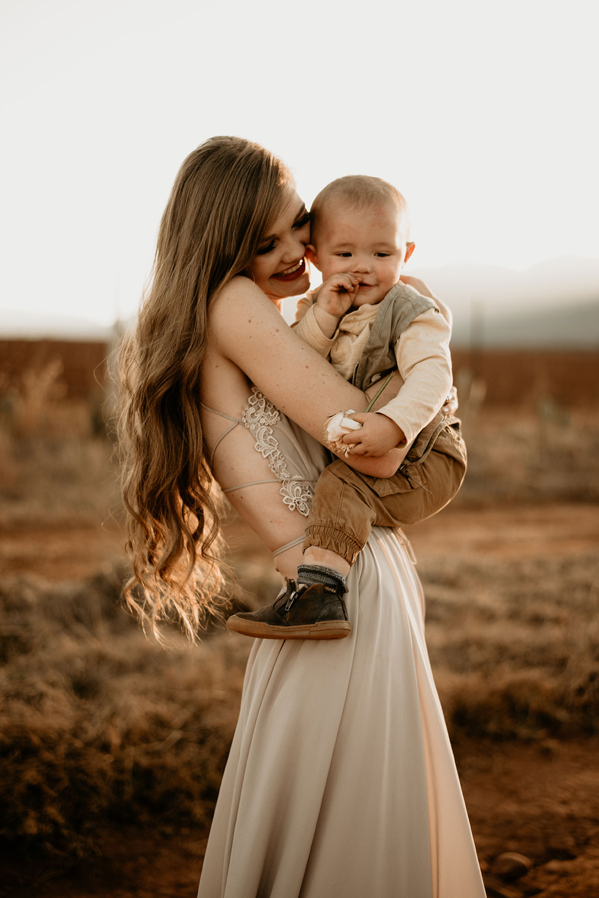 Mom hugging her boy at The Nut Farm Venue by Echo Photography