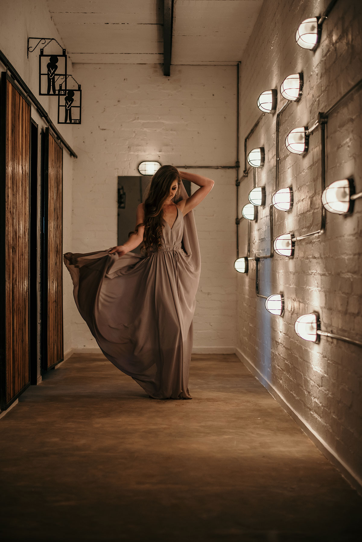 Flowing dress in Industrial setting at The Nut Farm Venue by Echo Photography